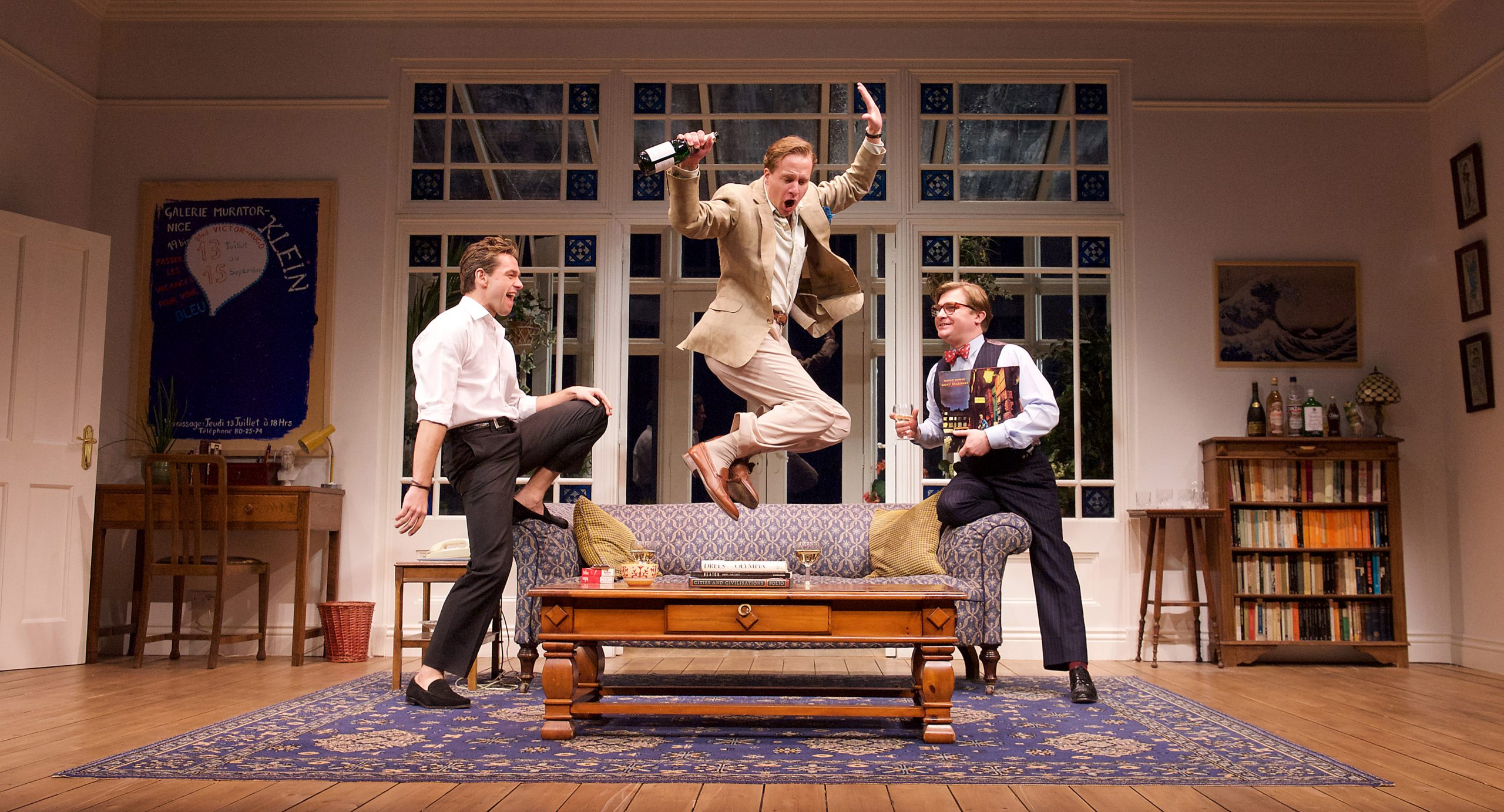 My Night with Reg  by Kevin Elyot  at the Apollo Theatre, London, Great Britain  Press photocall 20th January 2015   Julian Ovenden as John Geoffrey Streatfeild as Daniel - jumping  Jonathan Broadbent as Guy     Photograph by Elliott Franks  Image licensed to Elliott Franks Photography Services